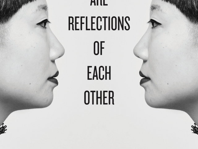 Two faces that are reflections of one another
