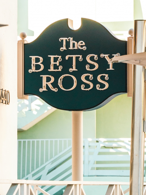 Bright daytime shot of the newly refurbished, navy blue vintage Betsy Ross sign