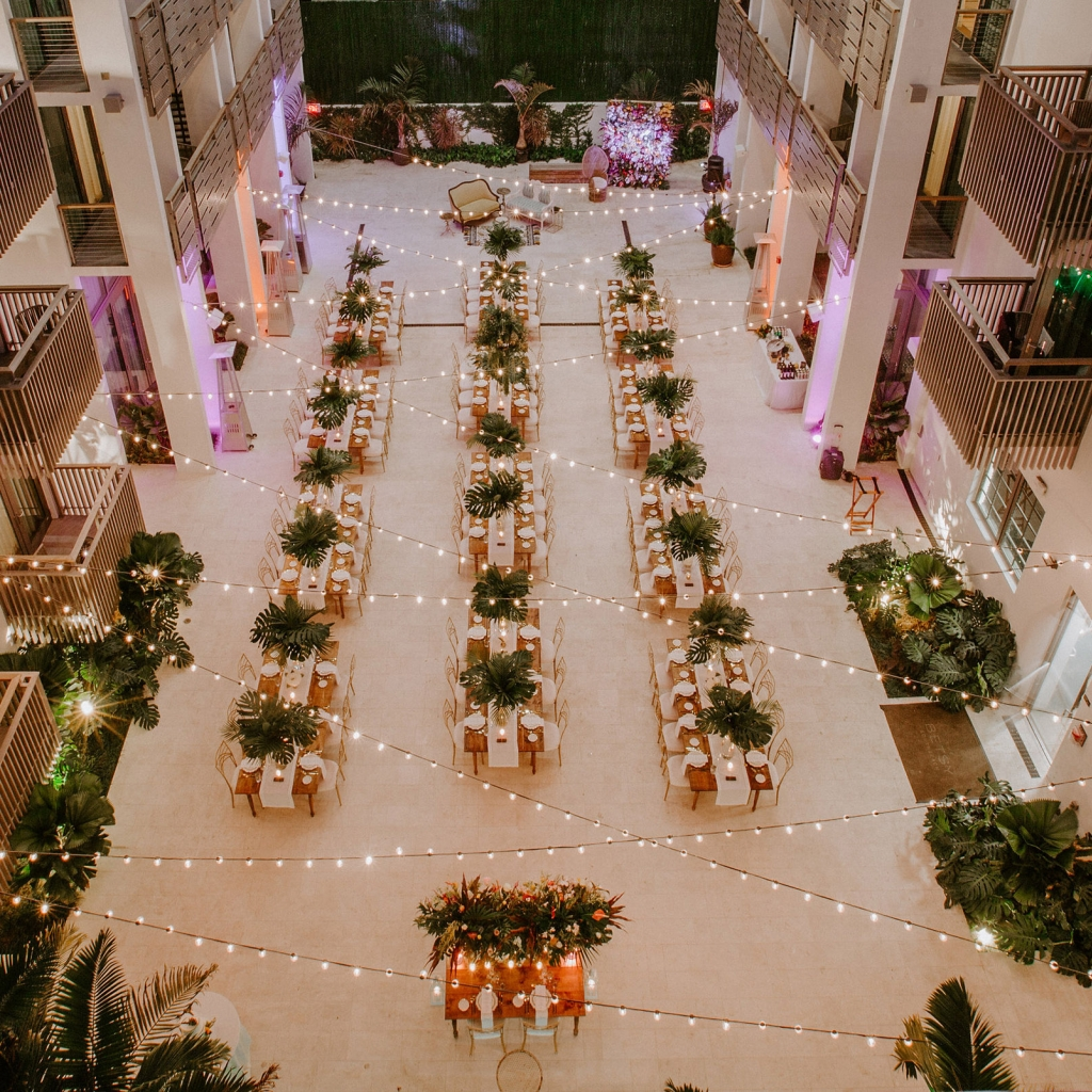 Overhead view of an atrium with string lights.