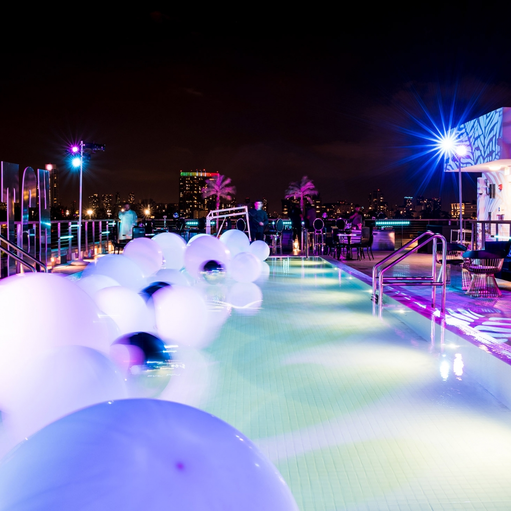 A rooftop pool at night.