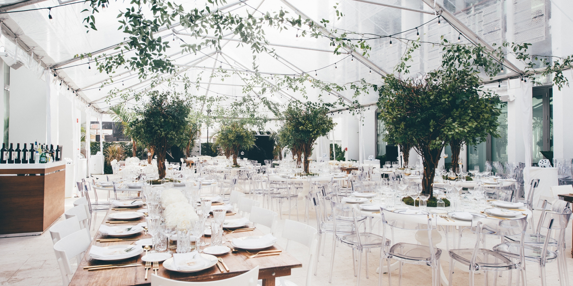 Tables set in a brightly lit atrium.